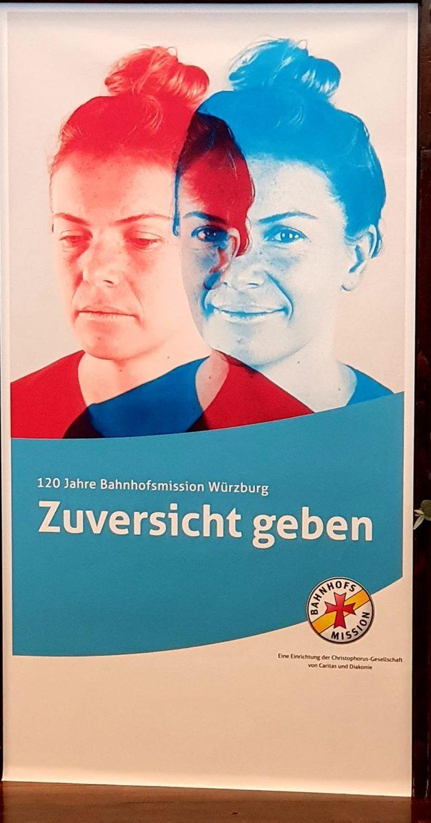 Plakat der Bahnhofsmission Würzburg.